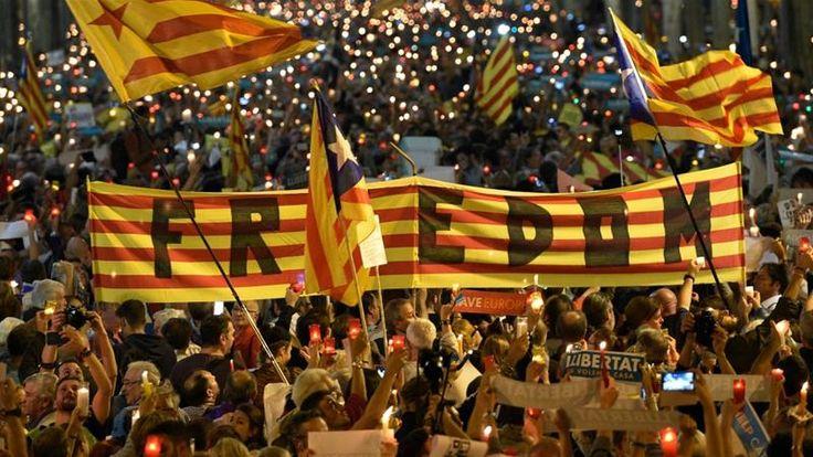 Thousands of people march in Spain demanding the release of imprisoned Catalan separatist leaders