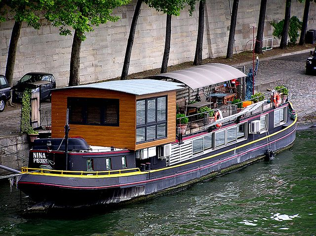 houseboat in Paris.  Black grey and red?