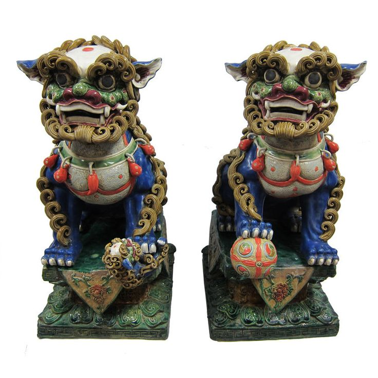 Chinese Foo Dogs | From a unique collection of antique and modern ceramics at http://www.1stdibs.com/furniture/asian-art-furniture/ceramics/