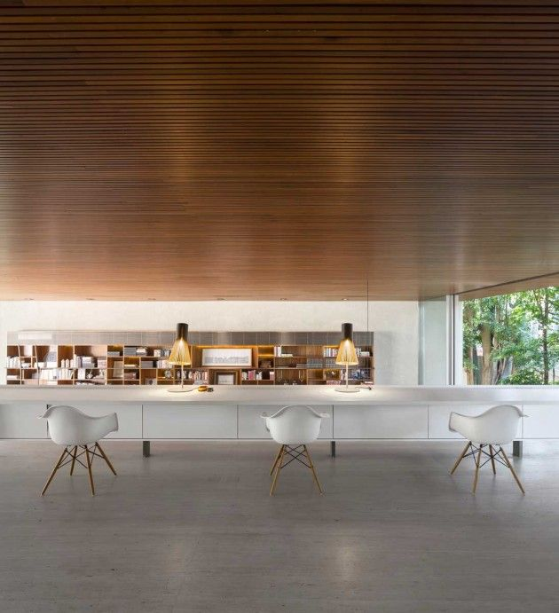 Modern Home Office // The Ultimate Workspace Using A Long Linear White Work  Surface Paired With White Eames Chairs At The Tetris House In Sao Paulo, ...