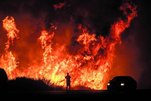 Raging wild fires strike West Coast again