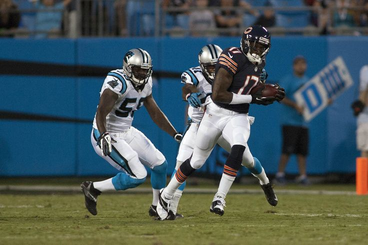 Chicago Bears wide receiver Alshon Jeffery runs after making a catch while being pursued by Carolina Panthers cornerback Captain Munnerlyn during the first quarter.