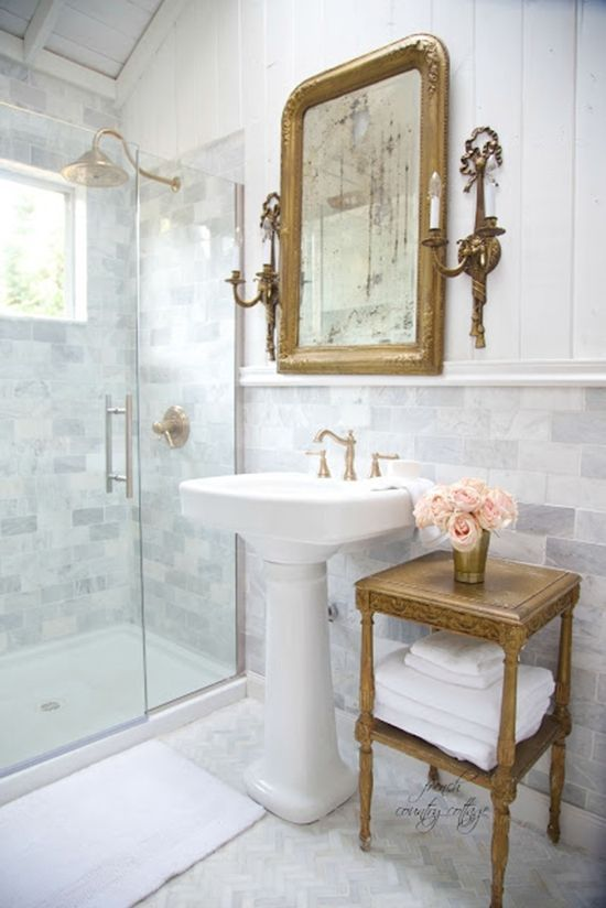Traditional bathroom with accent table next to a pedestal for French country bathroom lighting