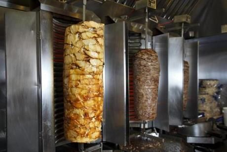 5/4/2015 - Boston, MA - Zo restaurant - These are the rotisseries of gyro meat. Topic: 20gyros. Story byJon Mael/Globe Correspondent. Dina Rudick/Globe Staff.