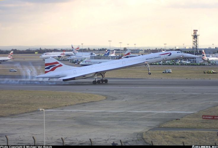 British Airways Aerospatiale-British Aerospace Concorde 102.  London Heathrow (LHR ) - October 24, 2003.  G-BOAG. Last of 3 arrivals with lots of staff and smoke.