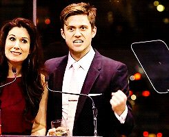 "I'm not sure what's going on here, but it's Stephanie J Block and Aaron Tveit. Stephanie is saying ""Thank God!"" and Aaron is doing a fist pump. It's beautiful"