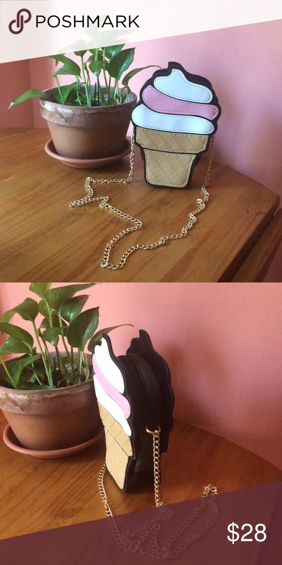 """🆕 Ice Cream Shoulder Bag Unique ice cream cone bag with gold chain strap and hardware. Black interior. No pockets. design on front only. Can be worn on shoulder or crossbody. Primary colors are pink, white, gold, tan/cream. 9"""" high without strap. Please ask if you have questions. Bags Shoulder Bags"""