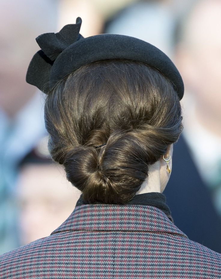 Duchess Kate has one seriously talented hair stylist on her books. The Duchess of Cambridge is almost as well known for her chic chignon's as she is her perfect blow dries. The Duchess, and her winning hairdo, joined the Duke of Cambridge to support the Queen in marking the 100th anniversary of the end first World War's Gallipoli campaign.