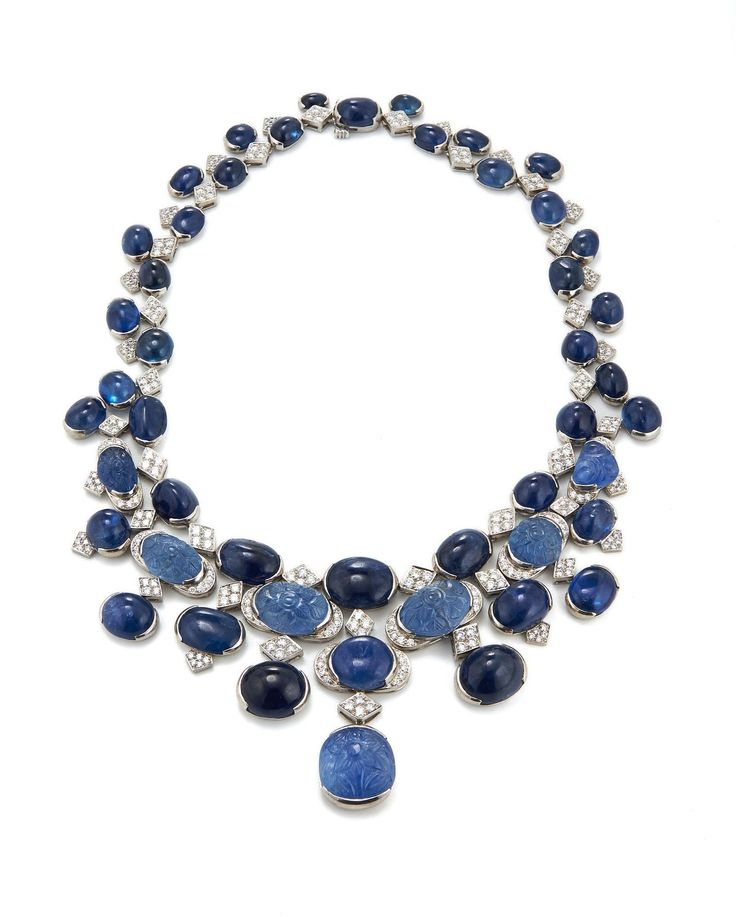 David Webb New York - Carved and cabochon sapphires, brilliant-cut diamonds, 18K white gold, and platinum