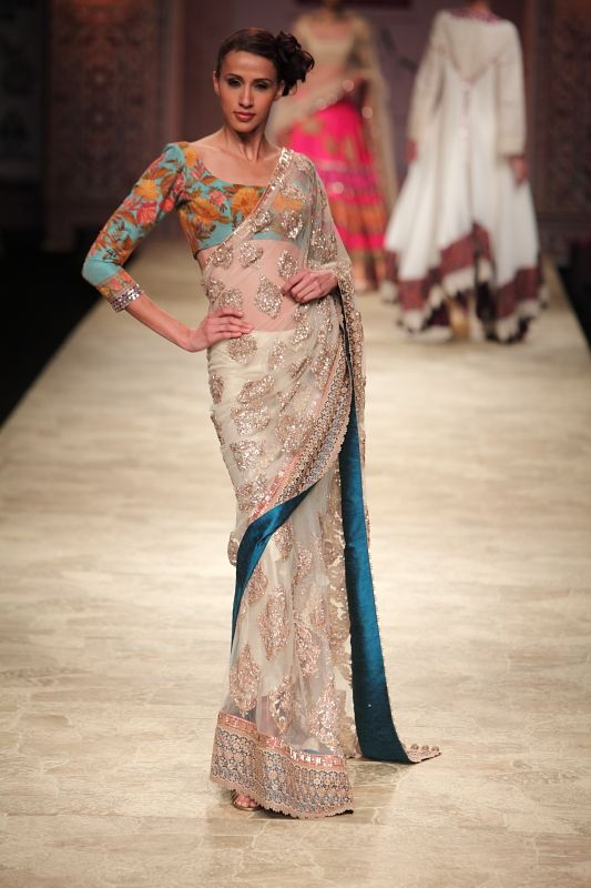 White sati with blue lining, Manish Malhotra...love the blouse!