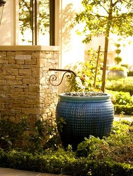 Consider a rain barrel with the look of, & possible double-duty of a fountain. The decorative spigot could easily be attached to a downspout, & a recirculating pump makes your rain barrel a fountain!