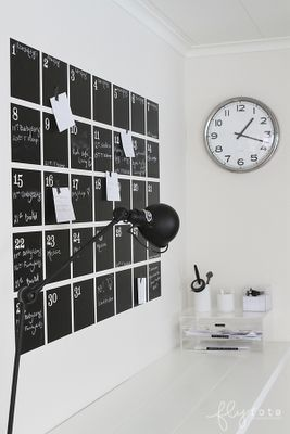 Chalkboard calendar. Maybe use magnetized chalkboard paint and make the numbers magnets