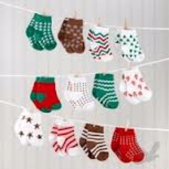Christmas baby shower - I love the idea of baby socks hanging from twine for ANY baby shower theme! for A's baby shower