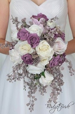 Cascading Teardrop Light Lavender, Wisteria and white wedding flower brides bouquet with lilies, orchids, lambs ear, seeded eucalyptus, lily of the valley, cherry blossoms, lots of greenery in these silk artificial wedding theme flowers