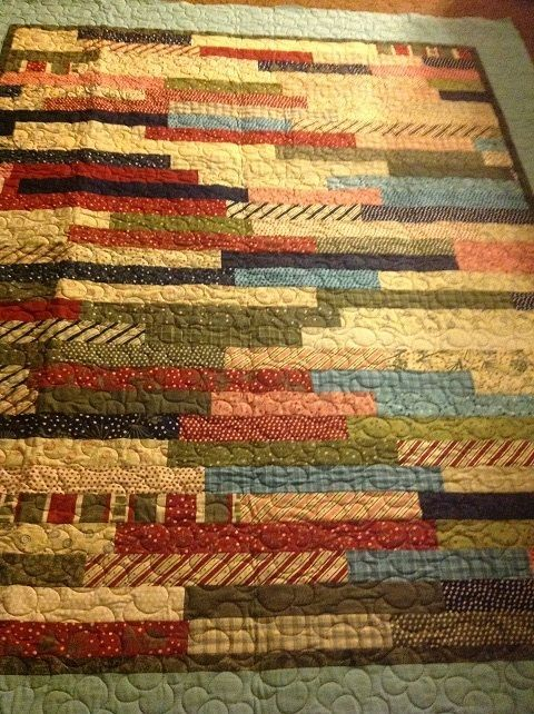 jelly-roll-1600-quilts cut 20 strips in half, then cut the other 20 strips into thirds (approximately 13 inches), which really helps with the scrappiness. Before sewing, I put the strips in the dryer on the air only setting for a few minutes to make it more scrappy.: