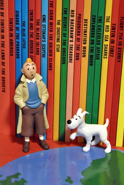 Tintin and Snowy in front of a Tintin collection.  This collector has Tintin in the Land of the Soviets!