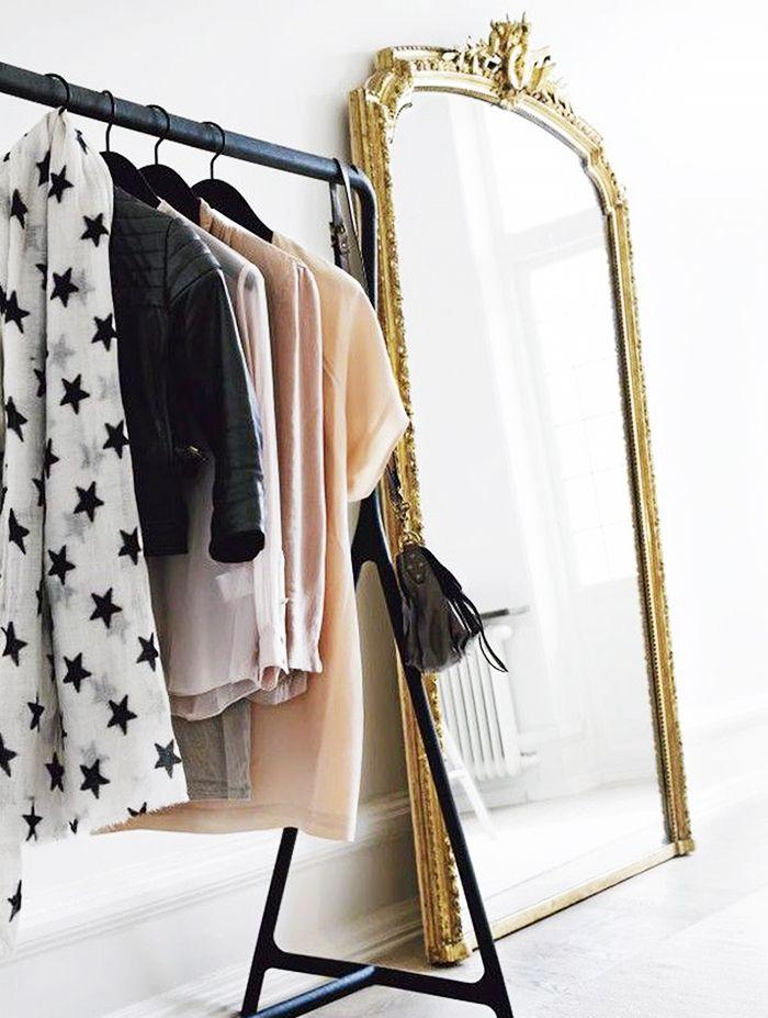 Makeshift closet ideas // Gold mirror + black clothing rack