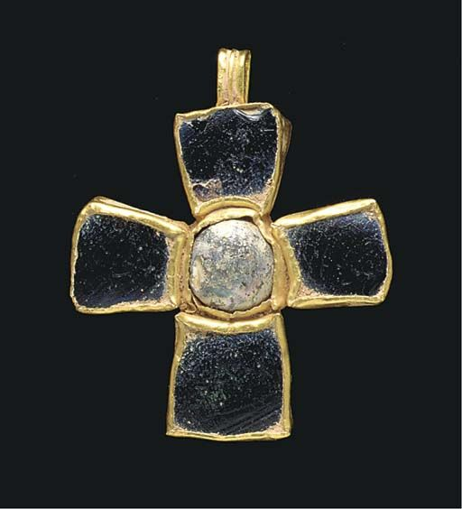 x x x ~ `A BYZANTINE GOLD AND GLASS PENDANT CROSS CIRCA 6TH-7TH CENTURY A.D. One side set with an aubergine glass inlay in each arm and a circular glass cabochon in the center, the other side with a raised foliate pattern branching from the center, a ribbed suspension loop above'