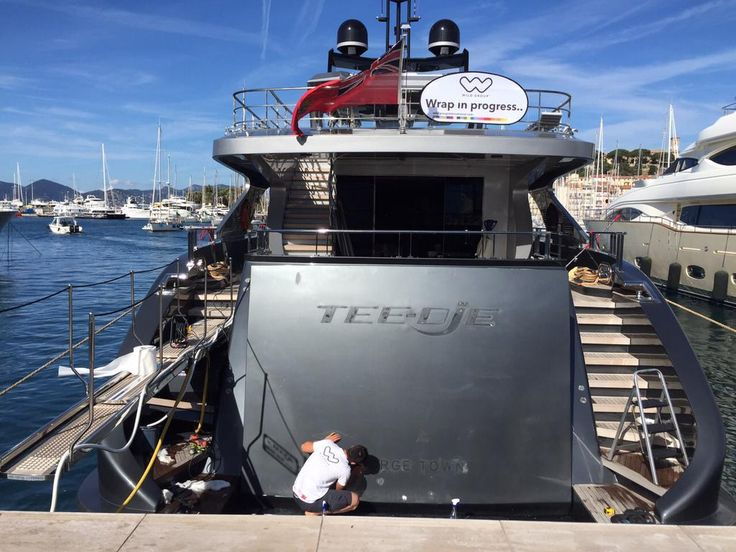 #WGITeam in #France wrapping garage doors & frame around them on this #MotorYacht in Avory #Vinyl #transformyouryacht