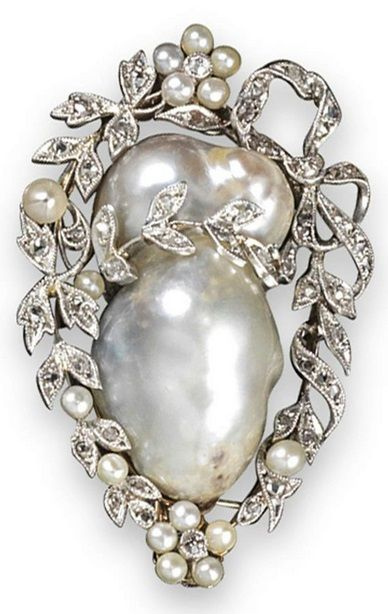 An early 20th century pearl and diamond brooch. The baroque pearl set within a surround of diamond and seed pearl swags and laurels in platinum and gold. 4.5cm wide. #Edwardian #antique #brooch