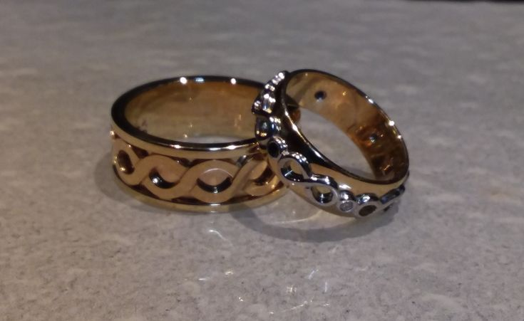 Custom made, His and Hers Infinity themed Wedding Rings