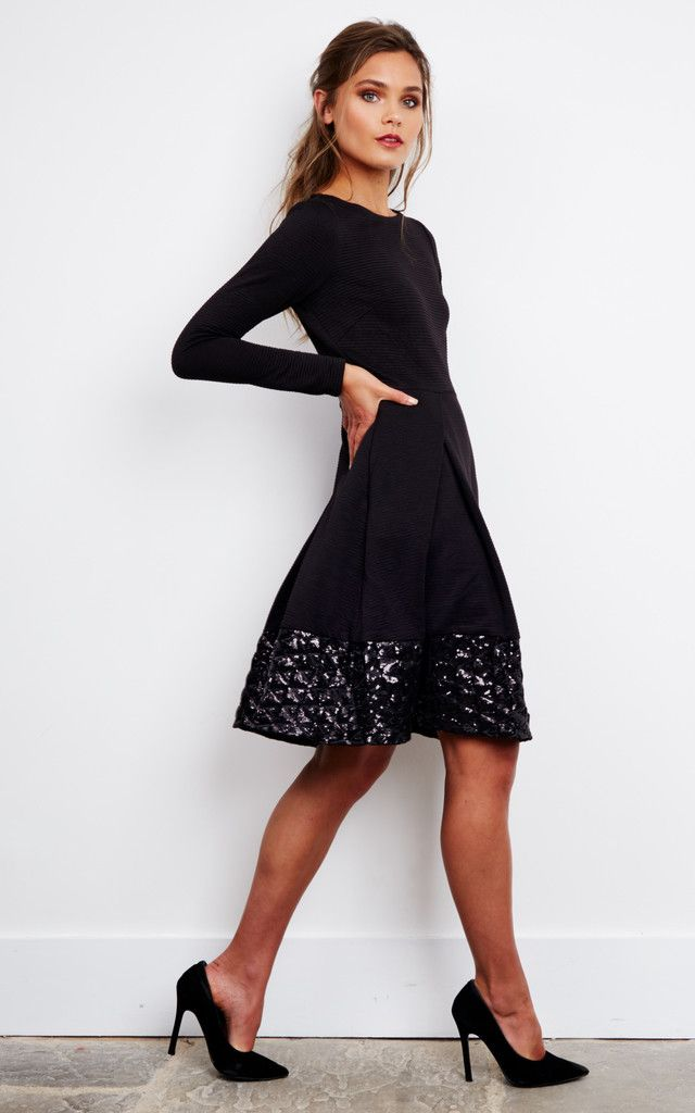 Shapely dress with 2 contrasting sections: the main is a soft textured fabric made with horizontal detailing, and the skirt is finished with a filigree border.  It has 2 side pockets and 2/3 zip at the back to close the dress sweetly.