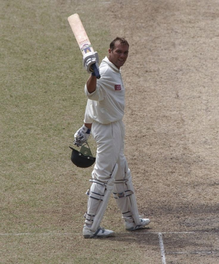 The innings that started it all: Jacques Kallis raises the bat after his match-saving knock of 101 - his maiden Test hundred - against Australia in Melbourne in 1997.