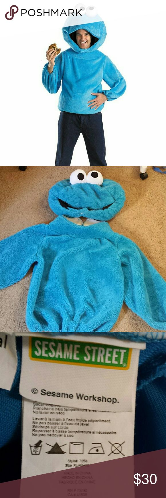Sesame Street Cookie Monster Costume Sesame Street Cookie Monster Costume  Blue plush pull over shirt, Velcro closure, Stuffed plush Cookie Monster character headpiece that fastens with Velcro under the chin. Pants not included.  Size XL. Worn twice. Excellent condition.   Bundle with my Miss Chocolate Chip costume for an awesome couples costume! Sesame Street Tops
