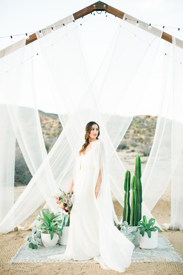Joshua Tree wedding inspiration desert backdrop ideas with cactus and potted plants by RO & Co. Events.