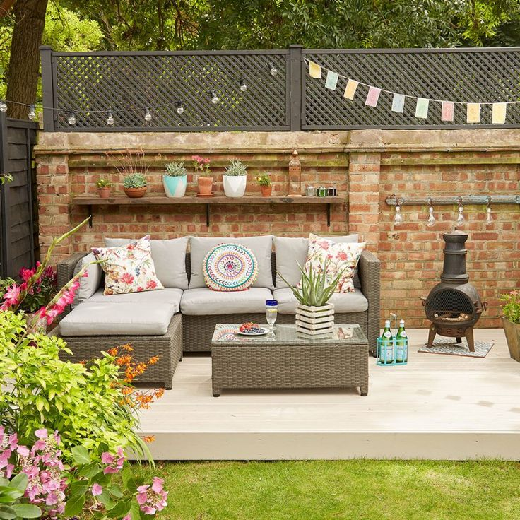Brightly coloured outdoor living room with wicker corner sofa