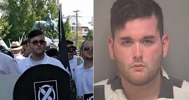 The driver of a car accused of crashing into a crowd protesting a white supremacist rally in Virginia had been photographed hours earlier carrying the...