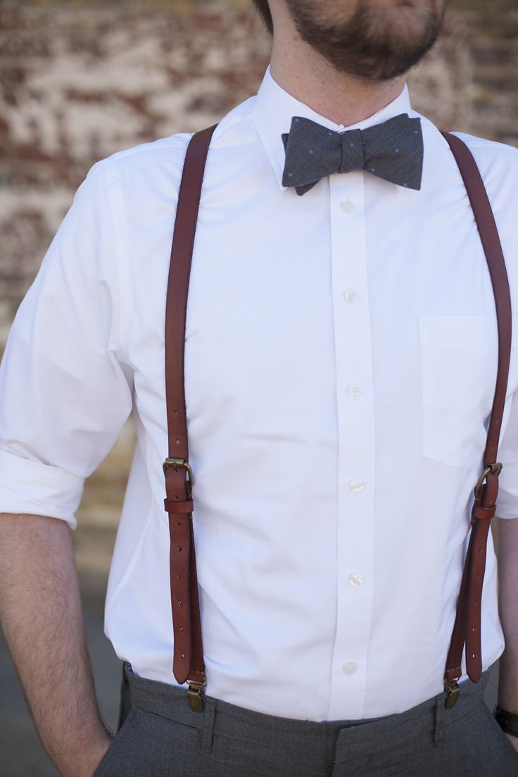 His groomsmen.   Bow ties - tiebar.com Leather suspenders - etsy.com  keywords: bowtie, leather suspenders, grey pants, dapper