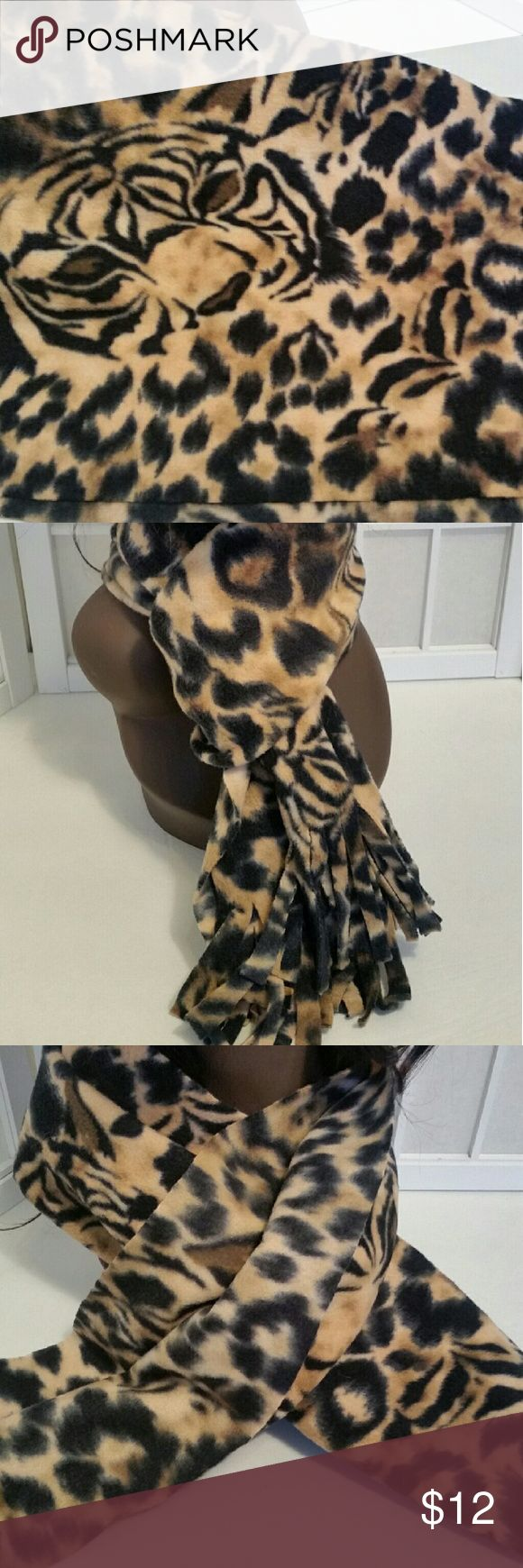 Nwot fringed animal print scarf Nwot fringed animal print scarf   Never worn  Excellent condition no flaws   Measures aprox. 12in.x54in.  No material content tag attached.. but I'm guessing polyester or acrylic 😉   ❣pictures are part of the description  ❣No trades or off site transactions/communications ❣Open to reasonable offers ❣same day shipping Mon-Sat if purchased before 2:30pm central time  ❣4.9 rating  ❣Please ask questions all questions BEFORE buying. ❣PLEASE do not rate me on how…