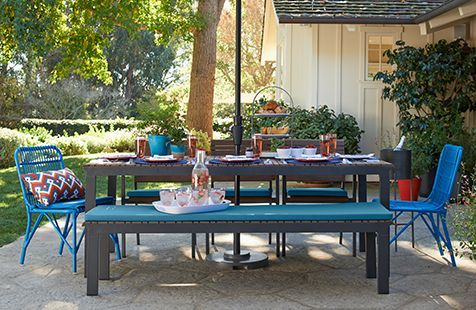 Backyard ideas...hedge outlining patio area, pops of color in furniture