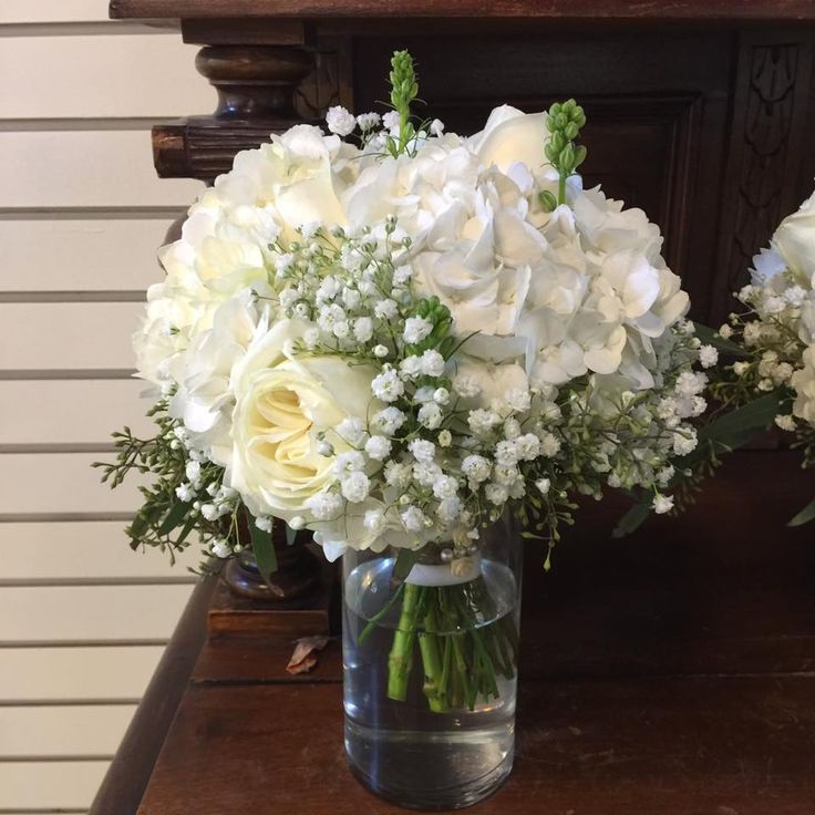 Bouquet by Flowers of the Forest: Bridesmaid Bouquet with White Polo Roses, Babies Breath, Eucalyptus & Larkspur.