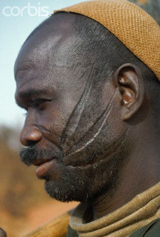 Africa  A Bobo man displays tribal scars on his face in Burkina Faso   Charles  Josette