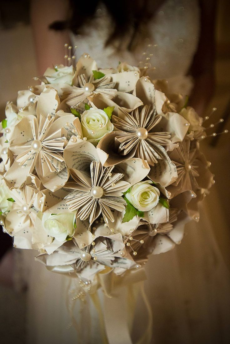 2014-10-21-HPBOUQUETPL6seRP1.jpg Bridal bouquet made from the pages of a favorite book. Via The Huffington Post