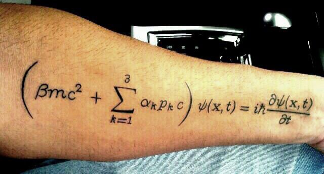 My Tattoo of the Dirac Equation Describes the Very Start of the Beginnings of Scientific Creations in its Rawest of Forms, from a Spinning Electron around the Proton of an Atom, to one of Thee Most Intense and Unstoppable Forces in the Whole Universe; a Quasar (a Spinning Super Massive Black Hole). Elegant and Horrendously Complex, is an Absolute Miracle of Compression. Very few Symbols between them Bring Together -Quantum Theory and Relativity- for the Spinning Electron.