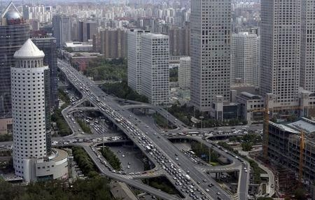 Guomao Bridge through Beijing's central business district, June 11, 2015. REUTERS/Jason Lee - China banks come back for more capital as bad loans pile up. Mounting bad loans are running down Chinese banks' capital buffers, forcing them to turn to investors for fresh funds despite raising a record amount last year.
