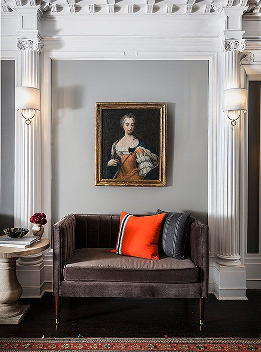 Plush velvet settees with channeled seams provide extra seating in the lobby.