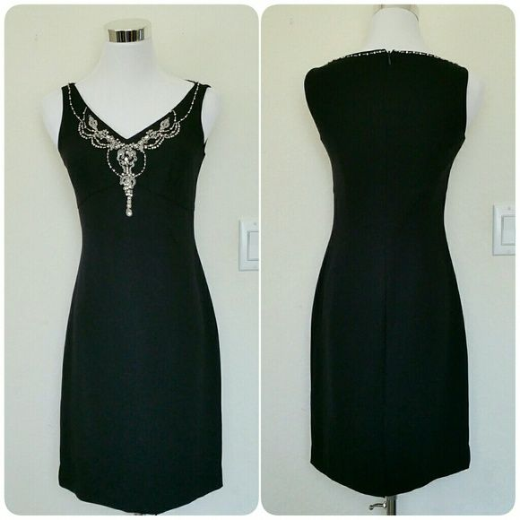 "Black jeweled embellished dress This is such a pretty dress. Nice jeweled detailing in the front and subtle detailing around the back of the neck. Perfect as a little black dress. Zips up in the back.   Measurements: Pit-pit = 16"" Waist = 26.5"" Shoulder-bottom = 33.5"" Petite Sophisticate Dresses"
