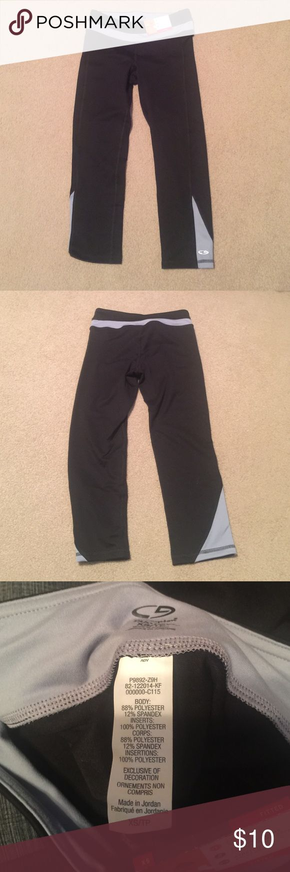 Brand new Champion workout Capris XS Fitted Never worn, black with gray fitted Capri workout pants. Size Xs Champion Pants Capris