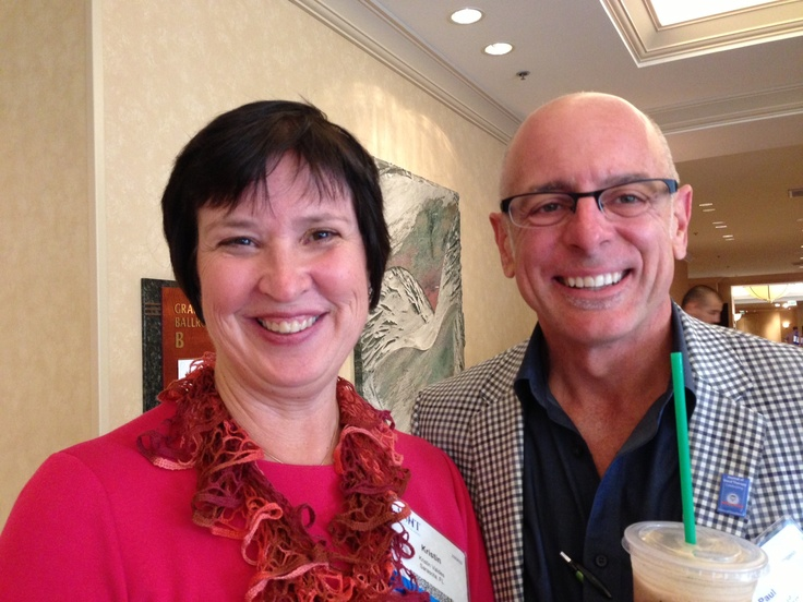 Kris valdes and paul lastayo at the 35th annual meeting