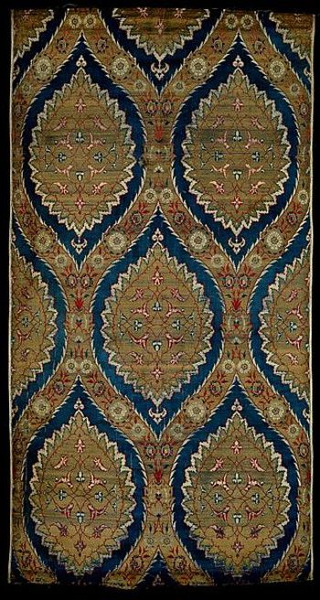 Ottoman textile pannel, probably made in Bursa, 1550-1600.  Silk and metal thread woven in the lampas technique. This textile was made from blue, red, black and white silk thread and a metal thread used to create areas of gold ground. It was woven in the lampas technique, in which two distinct types of weave (satin & twill) were combined using a drawloom, which had two sets of warps and wefts and a mechanism for creating the pattern, operated by a second weaver. (V&A Museum, London).