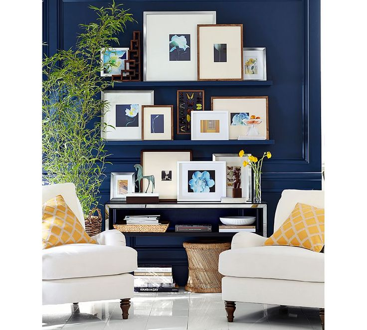 Create a gallery wall using wall mounted shelving. It gives you the versatility to change the look and art as the mood strikes you.