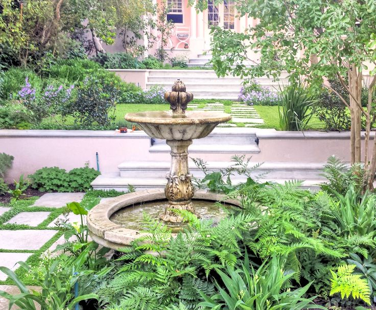 Water feature in a lush green courtyard as part of a project in a  Cape Town City Bowl garden