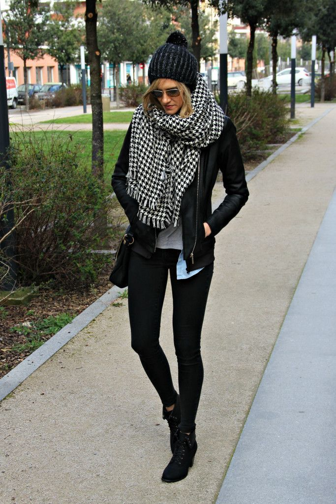 Street Style OOTD | Urban Fashion : black pompom beanie, faux-leather jacket, long-sleeve graphic t-shirt, denim button down shirt, black zip up hoodie, black faux-leather cross body bag, black lace up heeled shoes, Ray-Ban Aviators, black and white houndstooth blanket scarf