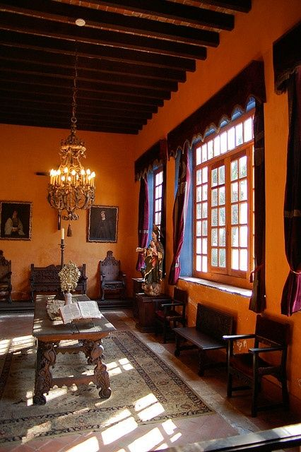 Love this wall color in this spanish inspired room