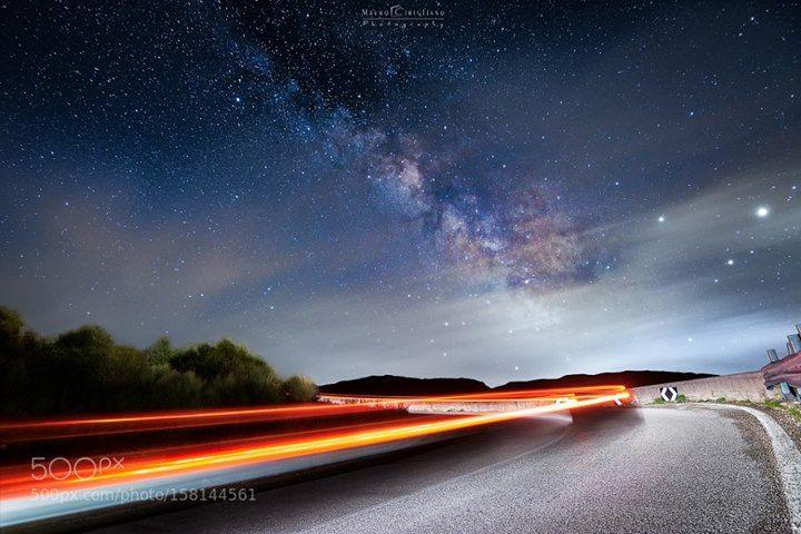 """Milky way road.  Follow me on Facebook page: http://ift.tt/1MX9w1w __________________________________  [Self-Car-Light-Painting]    Ancora lì su quella strada di ritorno che portava a valle. Ancora lì in quel tornante insidioso ma affascinante. Si ancora lì a divertirmi con il """"self car light painting"""" perché proprio non voleva passare nessuno... probabilmente per l'ora insolita ?  Lì divertendomi a comporre e guidare la mia auto per disegnare le scie nella foto mentre in realtà aspettavo…"""