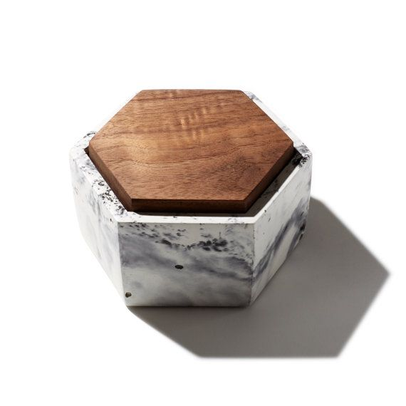 Store your treasured possessions in this small handmade hexagon concrete box. A great place to keep jewelry or small important items. Also great for